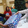 Globe/Roger Nomer<br /> (from left) Delonte Colbert, assistant general manager, Kim King, property accounts manager, and Greg Biastock, general manager, arrange presents at the Santa set at Northpark Mall on Tuesday.
