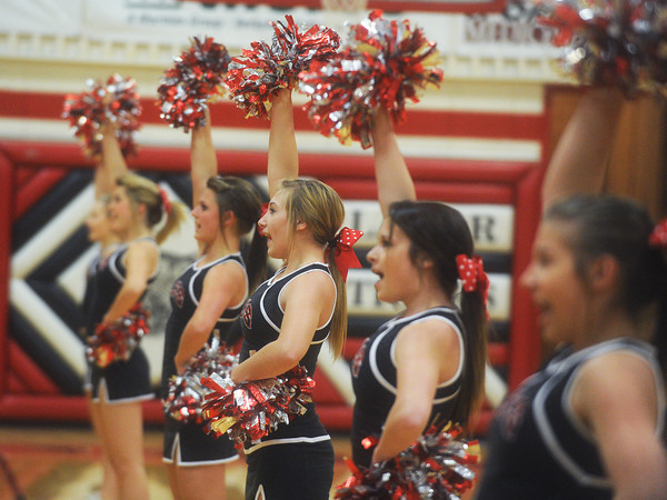 Globe/Roger Nomer<br /> The Lamar High School cheerleaders fire up the crowd during a football pep rally at the school on Tuesday afternoon.
