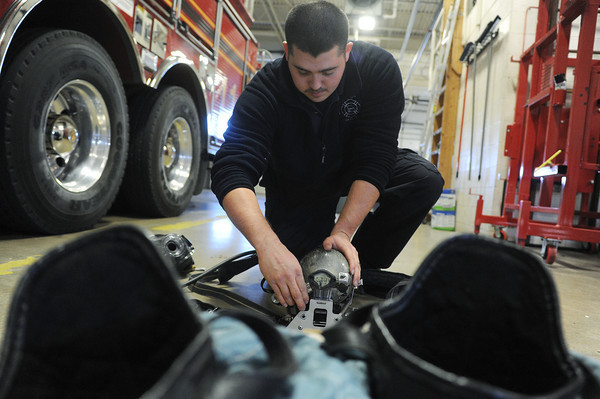 Globe/Roger Nomer<br /> Joplin Firefighter Justin Slates performs a daily equipment check at Joplin Fire Station One on Wednesday afternoon.