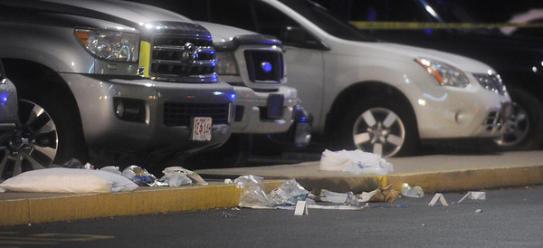 Globe/Roger Nomer<br /> Tags mark evidence in the shooting outside Regal Northstar Theater on Friday night.  Police say the shooting was targeted and that one male was transported to an area hospital.
