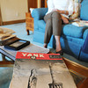 Nancy Harrison sits on the sofa in her home next to a copy of Yank, the Army weekly, her father purchased during World War II.<br /> Globe | T. Rob Brown