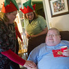 Globe/Roger Nomer<br /> Sara Heistand, RN with Avalon Hospice Care, left, and Melissa Williams, CNA with Avalon Hospice Care, served as helper elves for Todd Hombard during his shopping spree on Monday.