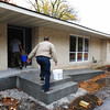 American Construction employees carry supplies inside Tuesday morning, Nov. 5, 2013, at the future Loving Grace House, 1414 Euclid, in Joplin.<br /> Globe | T. Rob Brown