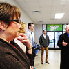 Charlotte McClure (left), Cable One general manager, listens to Joplin Regional Airport Manager Steve Stockam (right) along with the rest of the Economic Growth Tour group  Wednesday morning, Nov. 13, 2013, at Joplin Regional Airport's former main terminal.<br /> Globe | T. Rob Brown