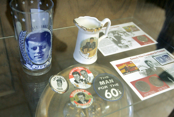 Globe/Roger Nomer<br /> Items in Louis Nicoletti's JFK collection include campaign buttons, coins and glasses.