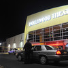 Globe/Roger Nomer<br /> Police tape cordons off the area of the shooting outside the Regal Northstar Theater on Friday night.  Police say the shooting was targeted and that one male was transported to an area hospital.