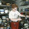 Globe/Roger Nomer<br /> Heather Grills looks through some of the empty bowls available for purchase at the Phoenix Fired Art gallery's charity event.