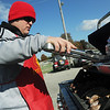 Globe/Roger Nomer<br /> Travis Akins, Pittsburg, tends the grill while tailgating before the Pittsburg State University football game on Saturday afternoon.