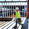 Carpenter Chuck Silverest of Ozark carries a metal stud Thursday afternoon, Nov. 7, 2013, during construction of the new Joplin High School. He works for PCI (Performance Contracting Inc.) interior division.<br /> Globe | T. Rob Brown