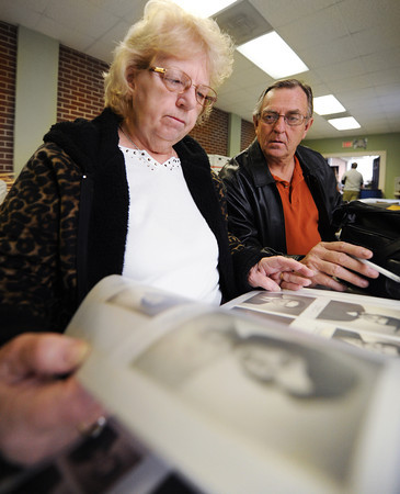 Kay and James Beeler, both of Joplin, look through images recovered during the Joplin tornado as part of the Lost Photos of Joplin Project Friday morning, Nov. 22, 2013, at the Joplin Museum Complex in Schifferdecker Park.<br /> Globe | T. Rob Brown