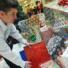 Globe/Roger Nomer<br /> Greg Biastock, general manager at the Northpark Mall, arranges presents for the Santa display at the mall on Tuesday morning.