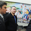 "Globe/Roger Nomer<br /> Local artists Jordan, left, and AJ Wood talk with Rep. Bill White following the unveiling of their mural ""Caring Hearts, Healing Hands"" in the atrium dining area of Freeman Hospital on Monday morning."