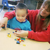 Globe/Roger Nomer<br /> Cheryl Dillard, a lead teacher at Cerebral Palsy of Tri-County, helps Christian Eichelberger, 4, with a Lego creation on Wednesday.