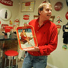 Globe/Roger Nomer<br /> Dave Mason talks about some of hs Coca Cola memorabilia during an interview on Thursday, Oct. 31.  Mason purchased a soda fountain from Scammon, Kan., and restored it in his basement.