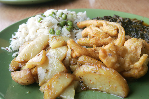 Globe/Roger Nomer<br /> Fried Vegetable Fritters, Potatoes in Yogurt Sauce, Sauteed Spinach and Sweet Peas in Rice.
