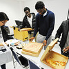 International students (from left) Areum Hong of South Korea, Kenneth Aleri of England, Osée Kalenda of Democratic Republic of Congo and Jimmy Njaroge of Kenya grab pizza during their meeting of the International Student Club Friday afternoon, Nov. 15, 2013, at Crowder College in Neosho.<br /> Globe | T. Rob Brown