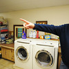 Executive Director Brian Brisbee looks around in the laundry room while touring the Carthage Crisis Center Monday, Nov. 11, 2014.<br /> Globe | T. Rob Brown