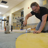 Globe/Roger Nomer<br /> Gene Geringer, with Commercial Floor Works, installs vinyl tile at Irving Elementary on Wednesday.