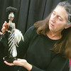 Globe/Roger Nomer<br /> Toni LoPresti works with her Starlight Splendor Barbie doll, one of the Bob Mackie designed dolls in her collection.
