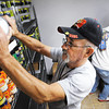 Ted Londo, pantry manager, stocks shelves as pantry employee Brian Branham works in the background Friday, Nov. 8, 2013, at Soul's Harbor in Joplin.<br /> Globe | T. Rob Brown