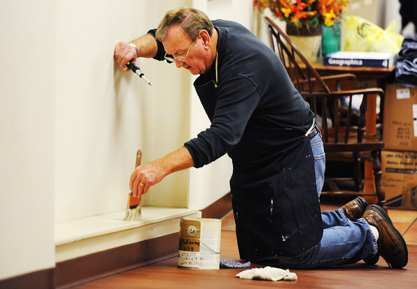 Volunteer Ed Ritzema of Carthage paints while performing maintenance work at the Carthage Crisis Center Monday, Nov. 11, 2014.<br /> Globe | T. Rob Brown