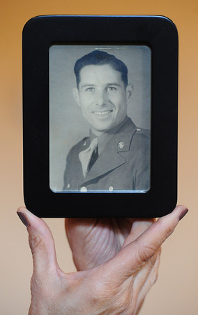 Nancy Harrison holds a photo of her father who wrote more than 150 letters to her mother during World War II.<br /> Globe | T. Rob Brown