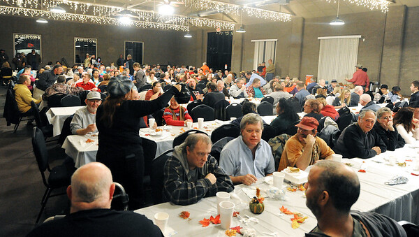 Some of the almost 500 guests at the  Neosho Community Thanksgiving Dinner gather in the Lampo Community Center on Saturday, Nov. 15. Globe | Laurie Sisk