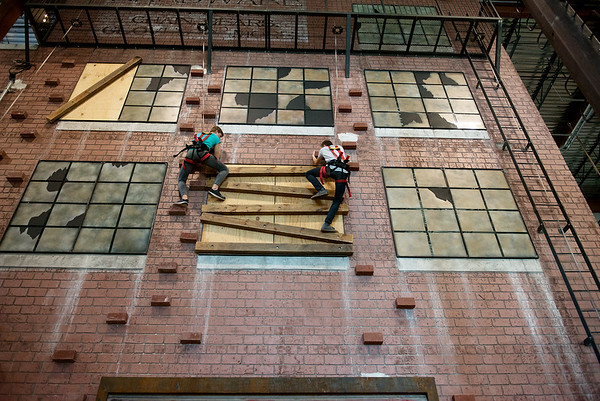 Globe/Roger Nomer<br /> Elec McCready, 15, left, and Hayden Engram, 14, climb the city wall on Wednesday at Fritz's Adventure.
