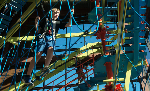 Globe/Roger Nomer<br /> Cole Engram, 13, walks through a rope course on Wednesday at Fritz's Adventure.