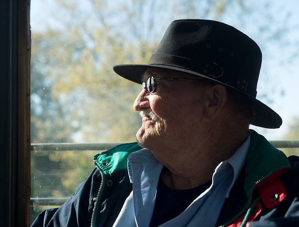 Globe/Roger Nomer<br /> Veteran Stanley Payne rides on the trolley on Friday in King Jack Park.