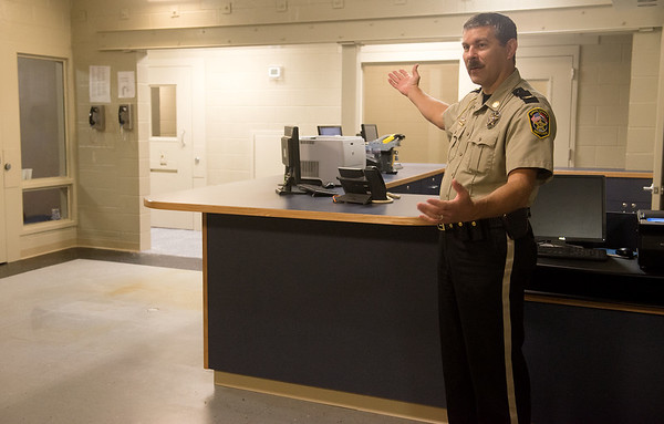 Globe/Roger Nomer<br /> Jasper County Sheriff Randee Kaiser gives a tour of the new booking area on Friday at the Jasper County Jail.