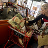 Globe/Roger Nomer<br /> Kathie Hinds put out merchandise at Rust and Stuff on Friday in downtown Joplin.