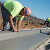 Globe/Roger Nomer<br /> Jose Reyna works on a curb on Tuesday at Wildwood Ranch.
