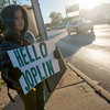 Globe/Roger Nomer<br /> Charlie Ladue, a fourth grader at West Central Elementary, greets motorists on Wednesday morning on Seventh Street outside the school.