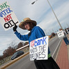 Globe/Roger Nomer<br /> Bill Rath, Carthage, holds signs to protest the Dakota Access Pipeline on Monday in front of US Bank on Range Line.