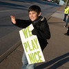Globe/Roger Nomer<br /> Quinten Dodson, fifth grader at West Central Elementary, waves at passing cars on Wednesday morning on Seventh Street outside the school.