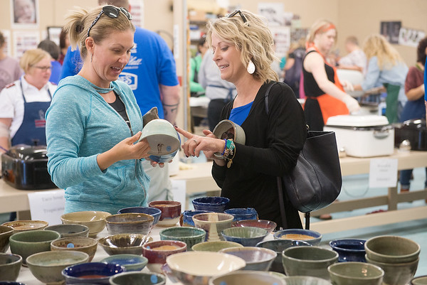 Globe/Roger Nomer<br /> Jacy Sheffer, left, and Sandi Krumsick, both of Joplin, look over empty bowls on Thursday at Phoenix Fired Art.