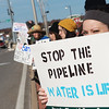 Globe/Roger Nomer<br /> Mollie Dyer, Joplin, holds a sign protesting the Dakota Access Pipeline on Monday in front of US Bank on Range Line.