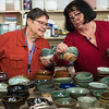 Globe/Roger Nomer<br /> Vickie Roettger, left, and Cynthia Campbell, both of Joplin, look at empty bowls on Thursday at Phoenix Fired Art.