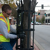 Globe/Roger Nomer<br /> Jess Reece, with the City of Joplin, strings Christmas lights on Monday morning on Main Street.