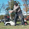 Globe/Roger Nomer<br /> Vance Meares plays golf with his son Kelly on Thursday at Range Line Golf.