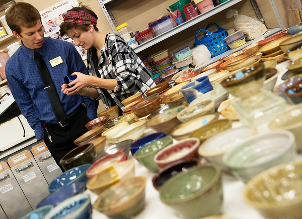 Globe/Roger Nomer<br /> Peter Thompson and Jordan Murdock, both of Joplin, look at their selection of bowls on Thursday at Phoenix Fired Art.