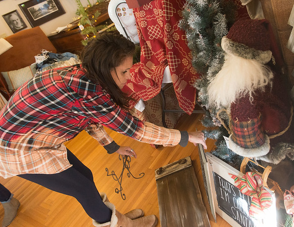 Globe/Roger Nomer<br /> Julissa Russell sets up a booth for Simply Vintage on Tuesday at the Missouri Southern Ralph L. Gray Alumi Center for the Third Annual Boutique Bonanza.