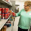 Globe/Roger Nomer<br /> Marge Ellis works in the food pantry on Monday at Crosslines.
