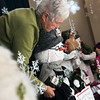 Globe/Roger Nomer<br /> June Stokes arranges a snowman on Monday in the window of City Hall.
