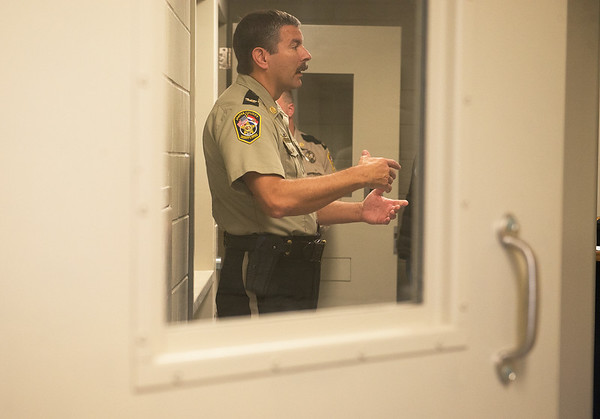 Globe/Roger Nomer<br /> Jasper County Sheriff Randee Kaiser gives a tour of the new holding cells on Friday at the Jasper County Jail.