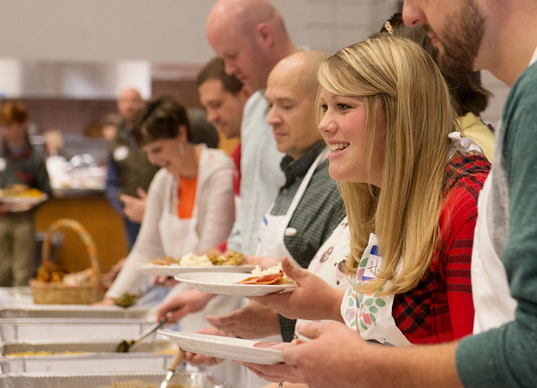 Globe/Roger Nomer<br /> Hannah Palmer serves a plate on Thursday at the First United Methodist Church.