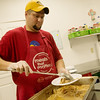 Globe/Roger Nomer<br /> Michael Lortz works in the kitchen on Monday at Watered Gardens.