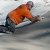 Globe/Roger Nomer<br /> Jason Conrad works on a drainage ditch on Tuesday at 10th and Peters.