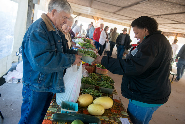 Globe/Roger Nomer<br /> Tim and Vi Green sell produce to Angela Hill, Carthage, on Saturday at the Webb City Farmers Market.
